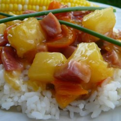 Ham and Pineapple Dinner Recipe - A great take on a Hawaiian-style dinner. This one's great for that leftover ham. Cubed ham sauteed with onions and pineapple in a sweet sauce. Kids love it and it's great served over rice or noodles.