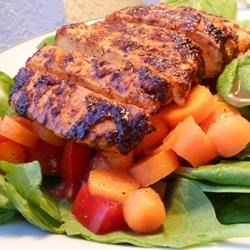 Indian-Style Grilled Chicken Salad Recipe - Spicy, tandoori-spiced chicken breasts are grilled and served with an Italian-inspired salad.