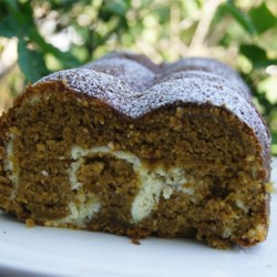 Pumpkin Swirl Bread Recipe - Ribbons of sweetened cream cheese swirl throughout this cinnamon- and nutmeg-spiced loaf.  This bread makes an especially attractive offering on your table when you serve it sliced, to show off how pretty it looks inside.