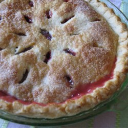 Fresh Rhubarb Pie Recipe - It doesn't take much to make rhubarb sing: some sugar, a bit of flour, and a pat or two of butter. When this lovely double-crust pie emerges from the oven, it's golden outside and sweet and luscious inside. It's especially nice with a scoop of vanilla ice cream.