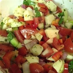 California Style Israeli Salad Recipe - Tomatoes, cucumber, bell pepper, onion, and jicama, are all tossed with a lemon vinaigrette for wonderful, fresh, full flavor. Beautiful, delicious, and a little bit different, it is very easy to prepare, and is sure to be a family favorite.