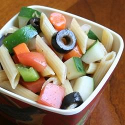 Summer Pasta Salad I Recipe - Penne pasta and fresh vegetables are tossed with Catalina and Italian-style dressings.