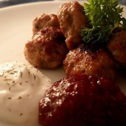 Swedish Meatballs (From a Swede!) Recipe - These tiny Swedish meatballs use a combination of ground beef and ground pork to make a flavorful appetizer for holidays or dinner parties. Serve alongside vegetable sour cream or lingonberry sauce for an authentic Swedish meal.