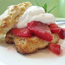 Buttermilk Strawberry Shortcake Recipe and Video - Light and airy buttermilk biscuits are topped with juicy, fresh strawberries in this dessert favorite.