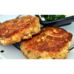 Best Ever Crab Cakes Recipe - A quick and easy crab cake that features buttery round crackers, tarragon, green onions, and red pepper flakes.