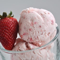 Easy, Eggless Strawberry Ice Cream Recipe - Made without eggs, the ingredients for this divinely creamy strawberry ice cream are a snap to mix and freeze in a home ice cream maker.