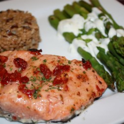 Sun-Dried Tomato Cedar Plank Salmon Recipe - This is a delicious version of a grilled salmon using cedar planks that have been soaked in water overnight to add smokiness and flavor to the salmon.