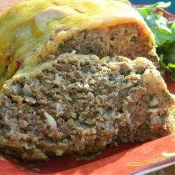 All American Meatloaf   Recipe - The whole family will love this classic, mildly-seasoned meatloaf topped with cheese. Some quick-cooking oats help the meatloaf hold together.