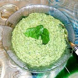 Pesto Del Sol Recipe - After they baste in the sun all summer  long, I cut down my basil plants and make this delightful pesto. This basil pesto has been mellowed with fresh spinach and enhanced by the taste of black olives. I make big batches and freeze in small container for the whole year. It will keep in the fridge for a week. Toss with pasta. Spread on meat or sandwiches. Add a spoonful for favoring to lots of recipes. Enjoy!