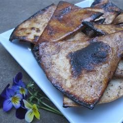 Praline Cinnamon Tortilla Chips Recipe - Flour tortilla pieces are dipped in canola oil and sugar seasoned with chili powder and cinnamon before being broiled until crisp to make delicious chips with the taste of crispy pralines. They're a great snack for Cinco de Mayo.