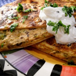Tangy Tuna Black Bean Quesadillas Recipe - These tangy black bean quesadillas are loaded with tuna, sour cream, and Mexican cheese for a hearty meal ready in less than 20 minutes.