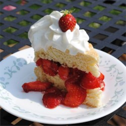 Strawberry Shortcake Recipe and Video - This old fashioned strawberry shortcake has tender, homemade shortcake layered with sweet strawberries and fresh whipped cream.