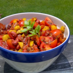 Sweet Pepper Balsamic Bean Salad Recipe -  Balsamic vinegar and Worcestershire sauce do their thing in this terrific salad. It 's colorful too. Black beans, red tomatoes, yellow peppers and green parsley to boot.