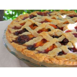 Summer is Here Triple Berry Peach Pie Recipe - Fresh, juicy peaches, strawberries, blueberries, and raspberries bake up in a pie that just screams 'summer is here!'