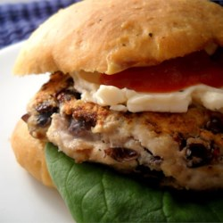 Black Bean Turkey Burgers Recipe - Japanese-style bread crumbs, egg, and Parmesan cheese help keep these ground turkey burgers with black beans hold their form on the grill.