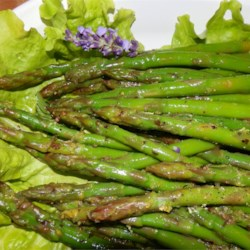 Zesty Marinated Asparagus Recipe - Tender asparagus is marinated in a balsamic vinaigrette and sprinkled with tangy lemon zest and fresh parsley. This is a quick and easy side dish.