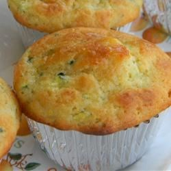 Lemon Zucchini Muffins Recipe - A sweet and tangy lemon glaze permeates these lemony, zucchini muffins for a yummy treat to go with your morning coffee.