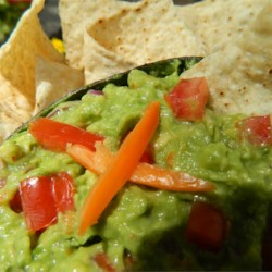 Habanero Guacamole Recipe - Habanero peppers and cayenne pepper combine to bring the heat to this creamy version of guacamole.