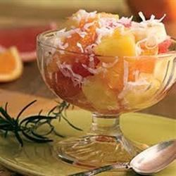 Momma Legs Ambrosia Recipe - Fresh oranges and apple are tossed with pineapple, coconut, and cherries in this fruit salad recipe.