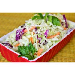 Lower-Fat Coleslaw Recipe - A light and tangy coleslaw has a small amount of fat so everyone can enjoy it as a side dish, on sandwiches, in wraps, or with burgers.