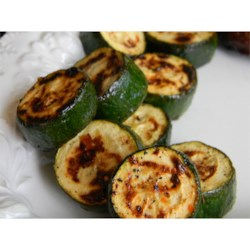 Easy Italian Grilled Zucchini Recipe - Marinating zucchini in Italian dressing before grilling is an easy way to make a delicious addition to your outdoor cooking menu.