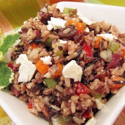 Mediterranean Brown Rice Salad Recipe - This Mediterranean-inspired salad combines brown rice with red bell peppers, raisins, olives, and feta cheese. It is tossed with a simple balsamic vinaigrette for a lunch or dinner salad.