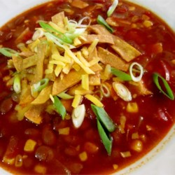 Healthier Slow-Cooker Chicken Tortilla Soup Recipe - This quick and easy chicken tortilla soup is made even healthier than the original by using skinless chicken strips, reduced-sodium chicken broth, and a lot of additional veggies for a flavorful and colorful topping.