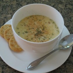 Grandpa's Oyster Stew Recipe - Oysters simmered in shallots, cream, and sherry, topped with paprika: the perfect stew for a winter evening.