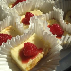 Cheesecake Lemon Bars  Recipe - This double-layered dessert is not only beautiful, but also delicious. A smooth cheesecake filling sits on top of a light lemony layer to make this the perfect finish to any meal.