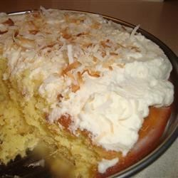 Tres Leches Pina Colada Cake Recipe - An easy version of the beloved tres leches cake is made with cake mix, pineapple, and cream of coconut to give the cake a pina colada flavor.