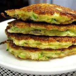Mom's Zucchini Pancakes Recipe - Crispy pan-fried vegetable pancakes make an easy side dish or appetizer. Serve with sour cream.