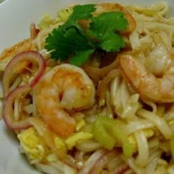My Husband's Pad Thai Noodles Recipe - This spicy shrimp pad Thai has a nicely balanced sauce that goes well with the rice noodles and Napa cabbage.