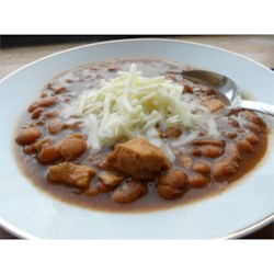 Chicken Chili I Recipe - Navy beans and chicken are combined in a broth seasoned with cumin, oregano and jalapeno in this soup to serve garnished with grated jack cheese and chopped green onion.