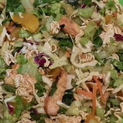 Easy Yummy Chinese Chicken Salad Recipe - The cooked dressing is flavorful and easy. And the salad is crunchy and fun. Shredded cabbage, lettuce, noodles, chicken, green onions and almonds. Serves twelve.