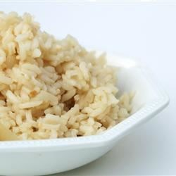 Brazilian White Rice Recipe - White rice is the main side dish made in Brazil.  This is the way my mom would make it and taught my sister and I.  What makes this so different is that we fry it in oil with minced onion and garlic before adding water.  You can also use part water, part chicken broth.  The secret is to not let it overcook because it should come out loose and not sticky.