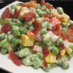 Green Pea Salad With Cheese Recipe - This easy pea salad has sweet, crunchy pieces of pickles, celery and peppers mixed with creamy bites of Cheddar cheese.