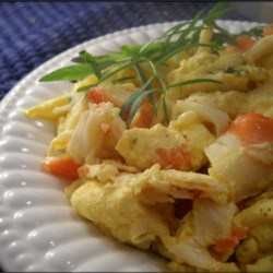 Lobster Scrambled Eggs Recipe - These butter-infused scrambled eggs with lobster have just the right balance of decadence and kick.