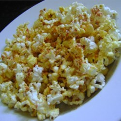 Popcorn Seasoning Recipe - The paprika and garlic salt in this popcorn seasoning mix adds a slightly smoky flavor to your popcorn.