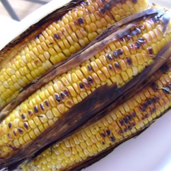 Miss Bettie's Zesty Grilled Corn Recipe - Fresh corn is shucked, placed on squares of aluminum foil, and drizzled with a spicy buttery concoction of mustard, horseradish, Worcestershire sauce and lemon pepper seasoning.