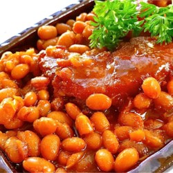 Boston Baked Beans Recipe and Video - This recipe for Boston baked beans uses navy beans, molasses, brown sugar, and ketchup to create a wonderful old-fashioned baked bean flavor.