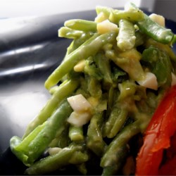Green Beans With a Twist Recipe - This is cold dish that combines green beans, hard-boiled eggs and mayonnaise with a hint of lemon and horseradish.