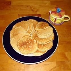 Pineapple Orange Pancakes Recipe - Orange juice and pineapple are a tasty twist to a morning favorite.