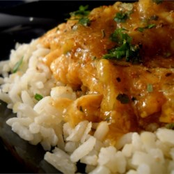 Orange Chicken Delight Recipe - Boneless chicken is cooked with vegetables and topped with the complementary flavors of adobo seasoning and orange marmalade. This dish is great served over rice!