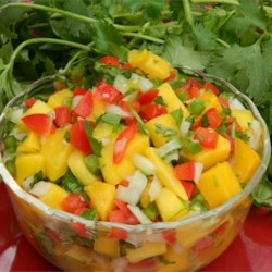 Mauigirl's Mango Salsa Recipe - Sweet onion and fresh ginger bring out the tropical flavors of ripe mango in this crowd-pleasing salsa.