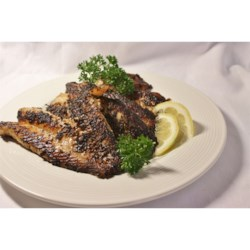 Cajun Blackened Catfish Recipe - Catfish fillets are coated with a spicy seasoning mix, and pan-fried outdoors in a hot cast-iron skillet for an  authentically Cajun main dish that's done in only a few minutes. Watch out, though, the smoke is intense.