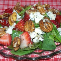 Everyone's Favorite Spinach Salad with Poppy Seed Dressing Recipe - Homemade poppy seed dressing tossed with spinach, blue cheese, and pecans is a perfectly flavorful salad for any occasion.