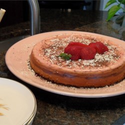 Neapolitan Cheesecake Recipe - Get out your mixing bowls: this luxurious cheesecake combines vanilla-white chocolate, bittersweet chocolate, and strawberry layers on a chocolate cookie crust. It may be served as is, or topped with strawberry preserves or ganache.
