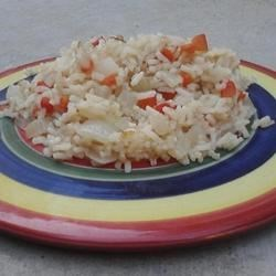 Maria's Spanish Rice Recipe - Rice is sauteed with onion and garlic, then simmered with pimento peppers.