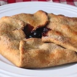 Cherry Folditup Recipe - Flaky, decadent pastry crust together with a luxurious cherry filling create a rustic tart.