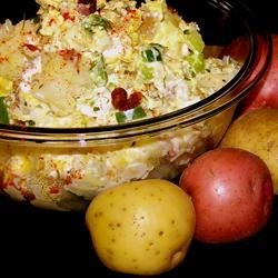 Mashed Potato Salad Recipe - These are so good, you'll want to run out in the middle of the night and buy up all the red and Yukon gold potatoes at the market. This dynamic duo and the mayonnaise/mustard/sour cream dressing, make all the difference. Serves six.